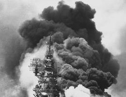 USS Bunker Hill hit by two Kamikazes