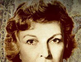 """Wytrwałość Marthy m.in. w Normandii przyniosła jej olbrzymią sławę (fragment znaczka z serii """"Amerykańscy Dziennikarze"""")."""
