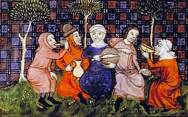 Grupa ubogich podróżnych spożywa chleb i wino. Czego jak czego, ale zboża w końcówce średniowiecza rzadko brakowało (źródło: domena publiczna).