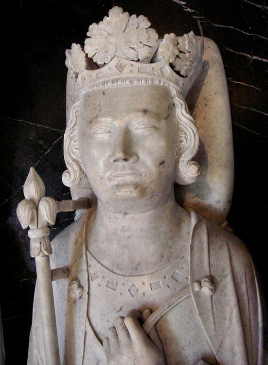 Grobowiec Filipa IV Pięknego w Saint-Denis. Ciekawe, czy autor rzeźby próbował przedstawić zadumę władcy nad losem jego potomków (fot. PHGCOM, lic. GFDL).