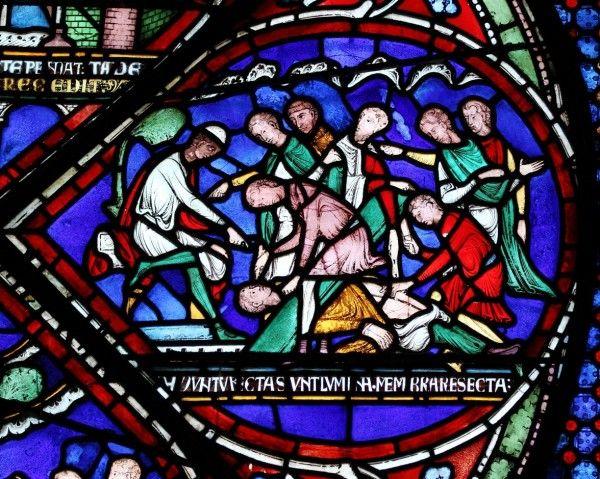 Oślepienie Ailwarda z Westoning, którego oczy miały się później w cudowny sposób zregenerować (witraż katedry w Canterbury).