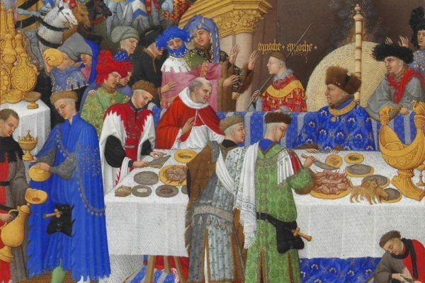 """Średniowieczne francuskie uczty wprawdzie były wystawne, za to do wykwintności wiele im brakowało (fragment karty poświęconej styczniowi z """"Bardzo bogatych godzinek księcia de Berry"""", źródło: domena publiczna)."""