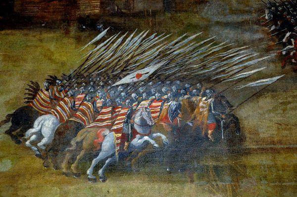 Pod Kłuszynem nie mogło być więcej niż 3080 husarzy. Na ilustracji husarska szarża na siły Dymitra Szujskiego pędzla Szymona Boguszowicza (lic. domena publiczna).