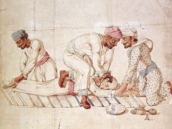 Thugowie podczas duszenia nieszczęsnego podróżnika, który zostanie złożony w ofierze Kali (źródło: domena publiczna).