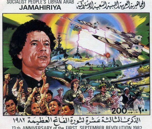 Aisza robi, co może, by w Libii przywrócić rządy ustanowione przez jej ojca w 1969 roku. Znaczek pocztowy z okazji trzynastej rocznicy rewolucji (fot. Felix O , lic. CC BY-SA 2.0).