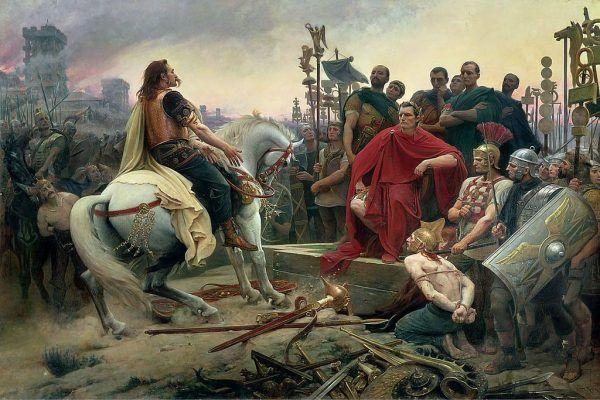 Wojny prowadzone przez Cezara kosztowały życie setki tysięcy ludzi. Na ilustracji kapitulacja galijskiego wodza Wercyngetoryksa przed Cezarem pod Alezją na obrazie Lionel-Noël Royera (źródło: domena publiczna).