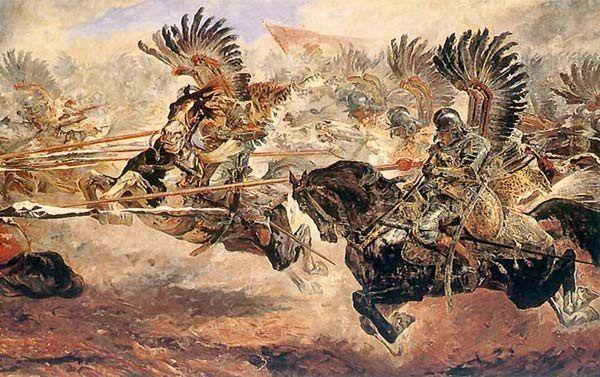 Szarża husarzy uzbrojonych w kopie.