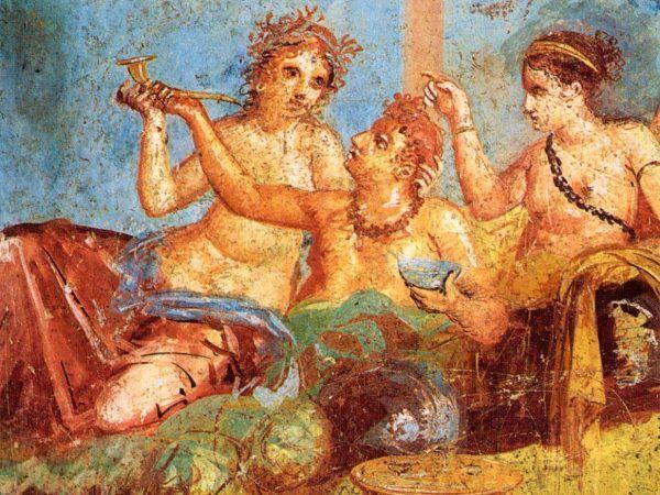 Nie ma dobrej uczty bez skąpanych w perfumach gołębi... Rzymski bankiet na fresku z Pompejów (domena publiczna).