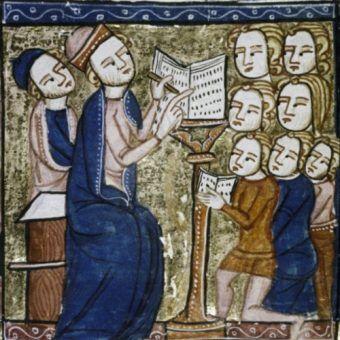 Nauczyciel i uczniowie w średniowiecznej szkole. Angielska miniatura z XIV stulecia.